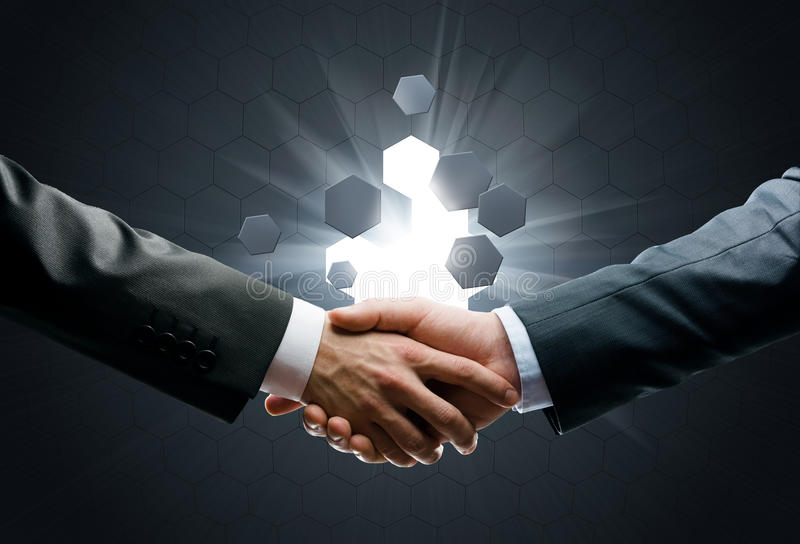 Close up of handshake on black background royalty free stock images