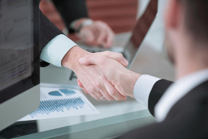 Close up. handshake of business partners above the Desk. royalty free stock photos