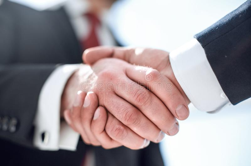 Close up.handshake business partners royalty free stock image