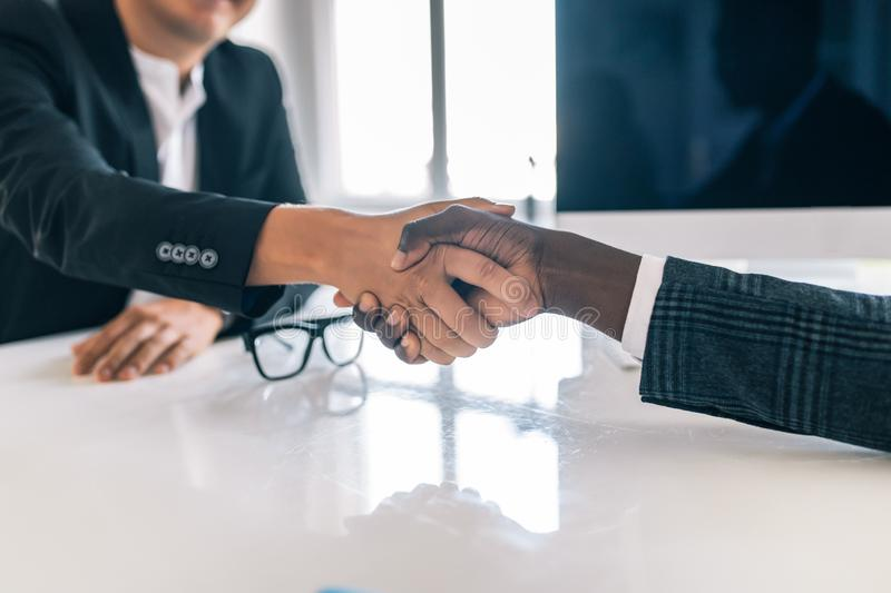 Close-up handshake of business partners in modern office royalty free stock photo
