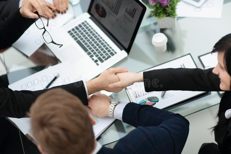 Close up.handshake business partners over the Desk royalty free stock images