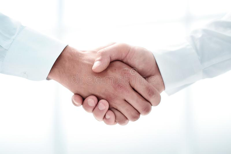 Close up.handshake of business people on a light background royalty free stock photo