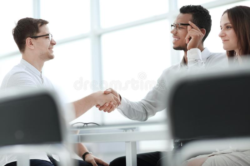 Close up.handshake of business people at a meeting in the office. stock images