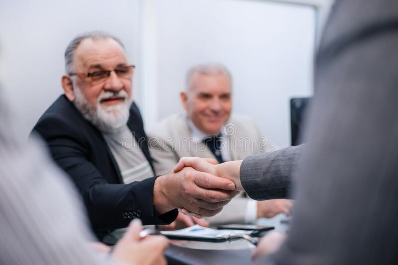Close up. handshake of business people during a working meeting. stock images
