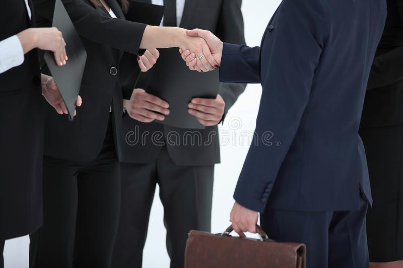 Close up.handshake business woman with businessman. on white stock photo