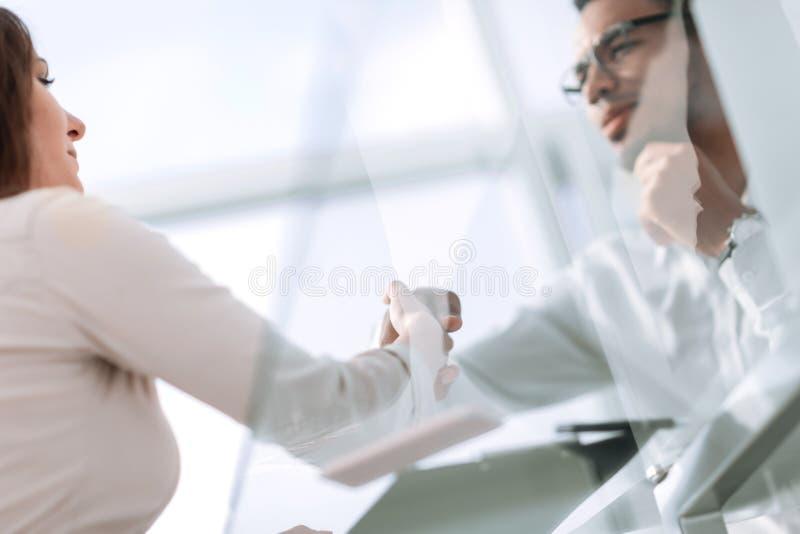 Close up. handshake of international business partners . stock photography