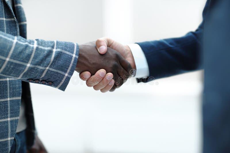 Close up.handshake of international business people stock photo