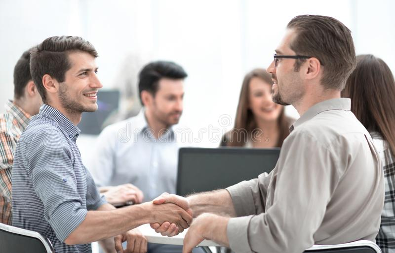 Close up.the handshake between the Manager and the employee at the Desk royalty free stock photos