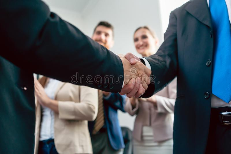 Close-up of the handshake of two business men after an important agreement royalty free stock images