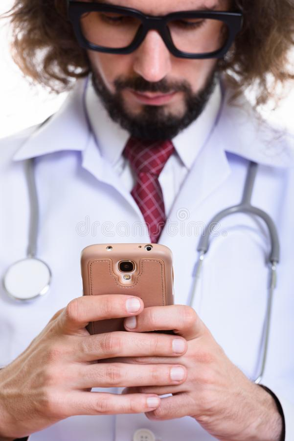Close up of handsome man doctor using mobile phone with focus on. Close up of handsome man doctor using mobile phone with on phone stock photos