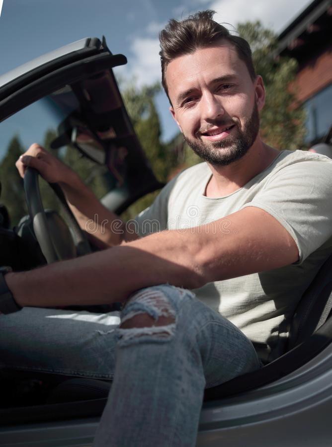 Close up.handsome young man sitting in convertible ca royalty free stock photography