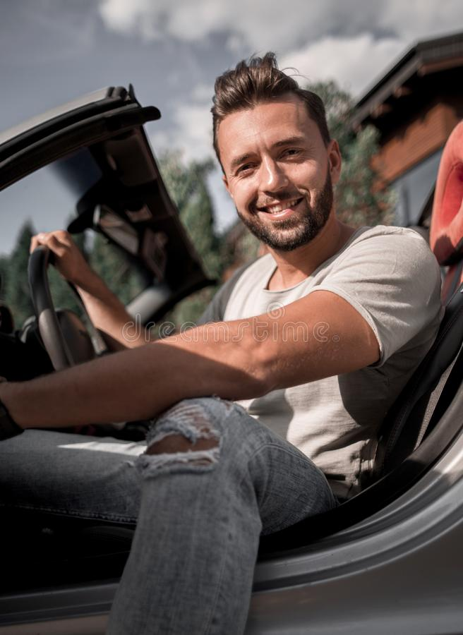 Close up.handsome young man sitting in convertible ca royalty free stock photos