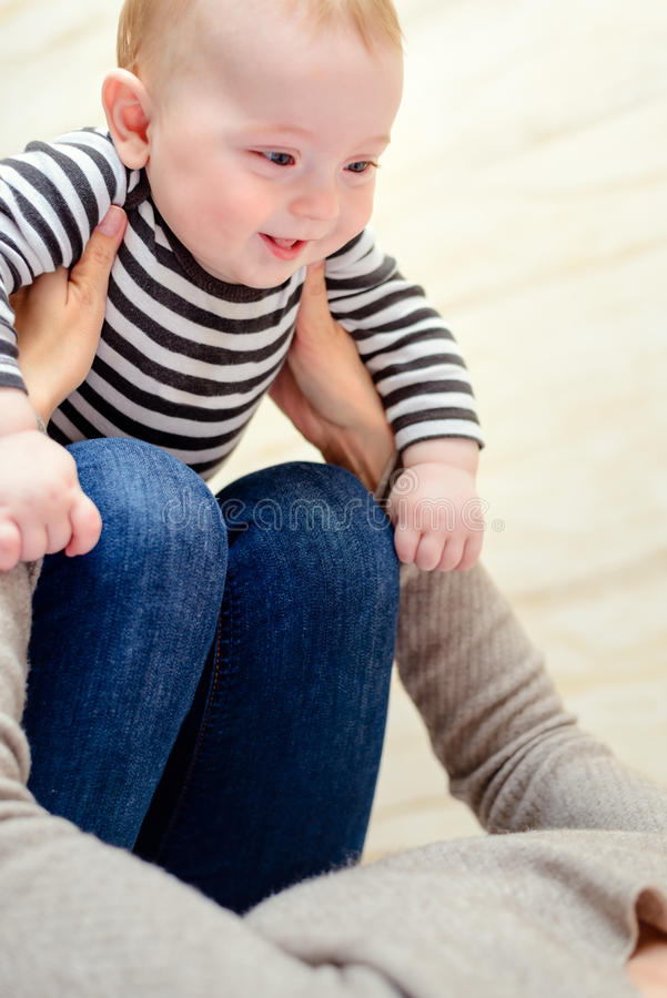 Close up of happy baby with playful parent stock images
