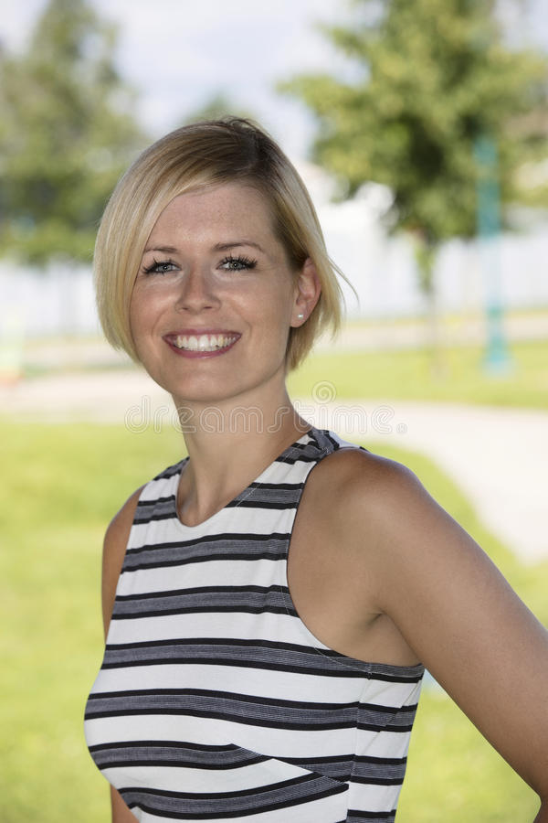 Close Up Of A Happy Blond Woman Smiling And Looking At the Camera. royalty free stock image