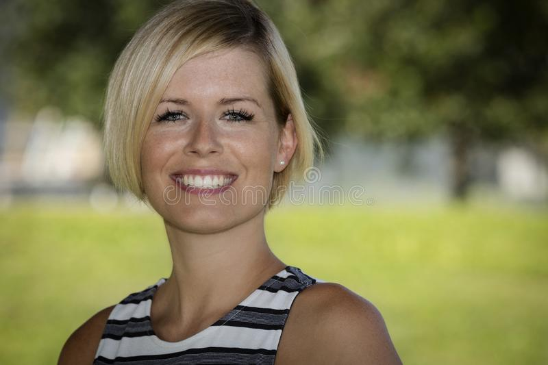 Close Up Of A Happy Blond Woman Smiling And Looking At the Camera. stock photography
