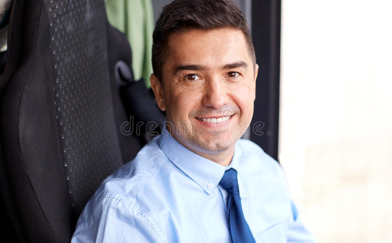 Close up of happy bus driver or businessman royalty free stock image