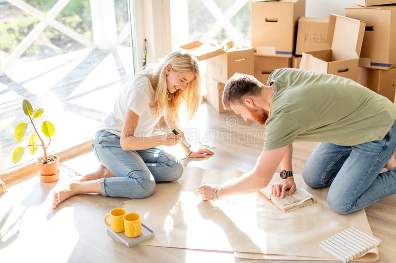 Couple looking blueprints of they new house. Planning interior design stock photography
