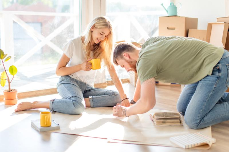 Couple looking blueprints of they new house. Planning interior design royalty free stock photos