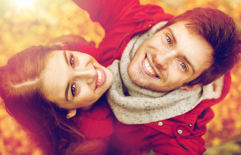Close up of happy couple taking selfie at autumn. Love, technology, relationship, family and people concept - close up of happy smiling young couple taking stock images