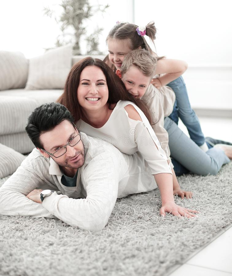 Close Up.happy Family In The Living Room Stock Photo ...