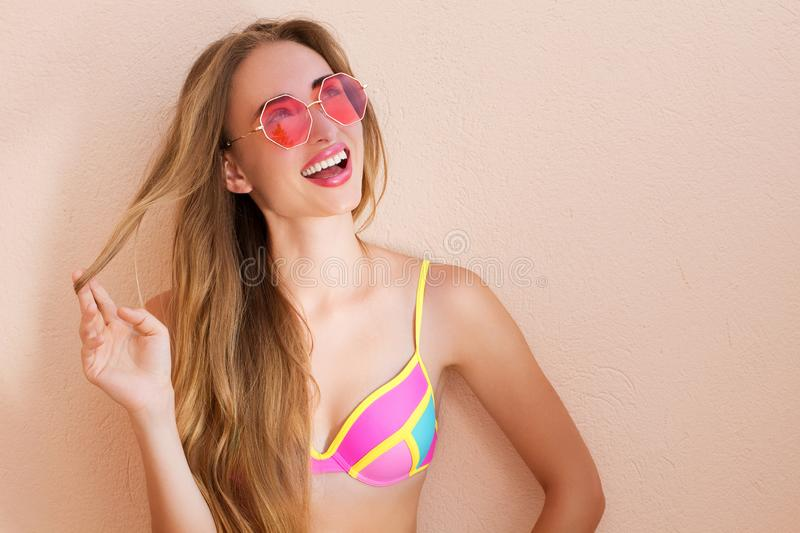 Close Up Of Happy Girl in pink sunglasses isolated. Summer holidays and fun time weekend. Summertime concept. Smiling young woman stock photo