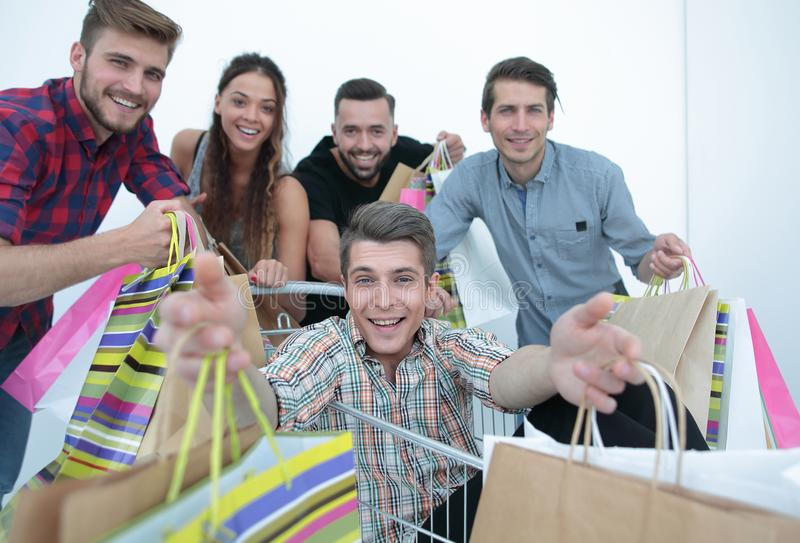 Close up.happy group of friends shopping stock photo