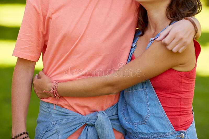 Close up of happy hugging teenage couple. Love and people concept - close up of happy hugging teenage couple royalty free stock photography