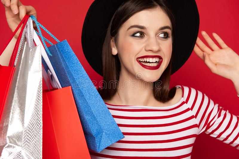 Close up happy lady with many shopping packs royalty free stock images