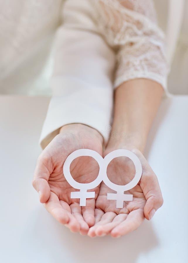 Close Up Of Happy Lesbian Couple With Venus Symbol Stock Image