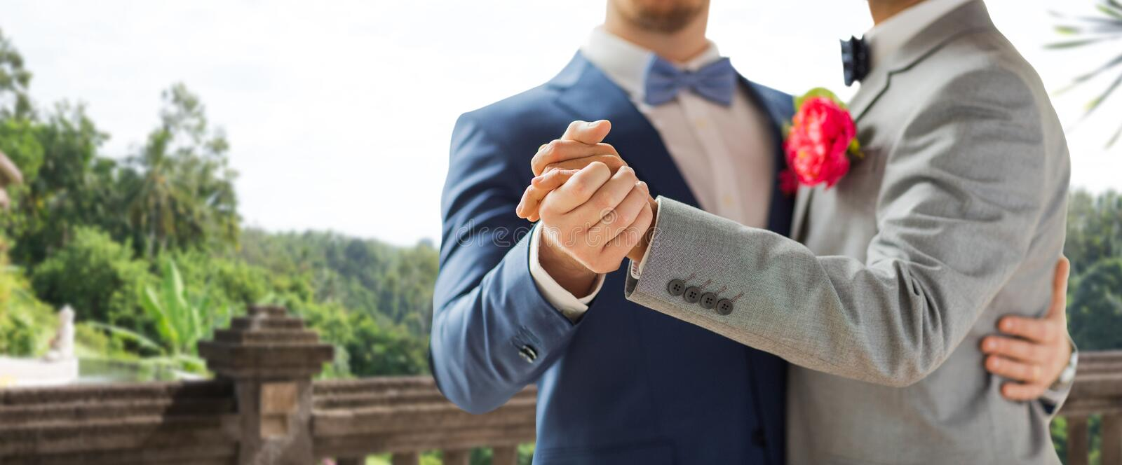 Close up of happy male gay couple dancing royalty free stock image