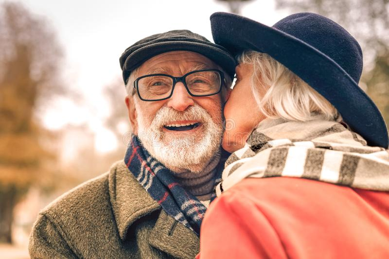 Close up of a happy smiling couple kissing in park stock images