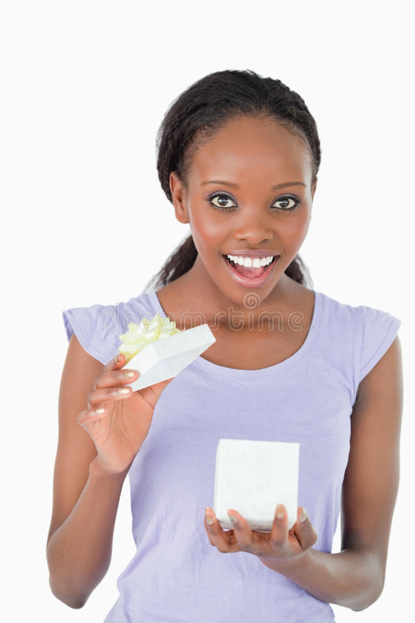Download Close Up Of Happy Woman Opening A Present Stock Photo - Image: 21860848