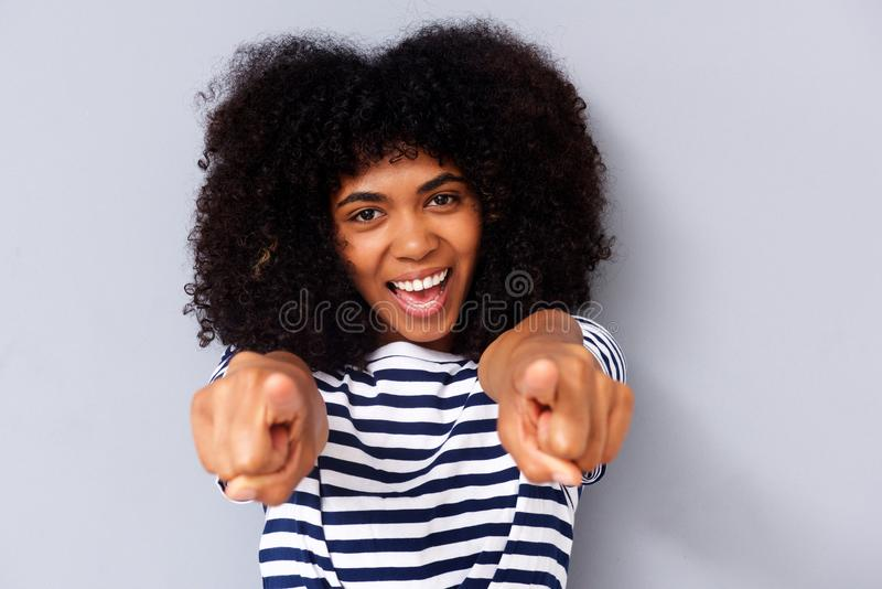 Close up happy young black woman smiling and pointing fingers. Close up portrait of happy young black woman smiling and pointing fingers stock images