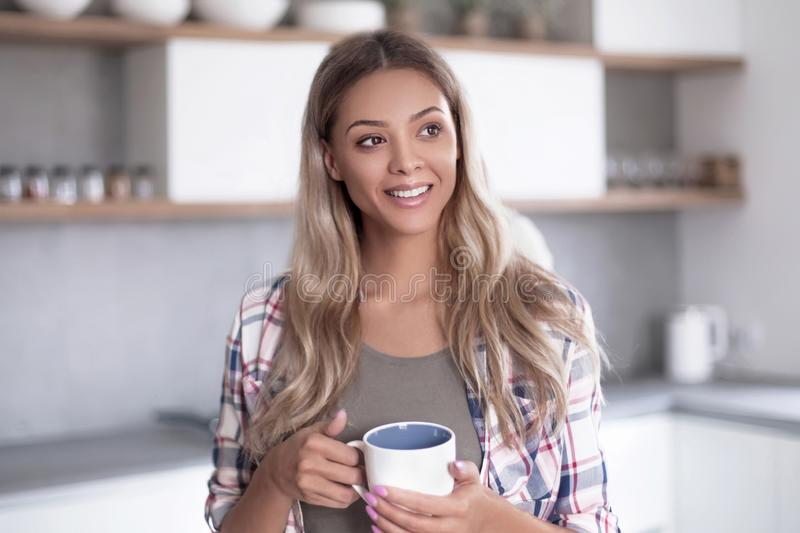 Happy young woman with Cup of coffee royalty free stock image