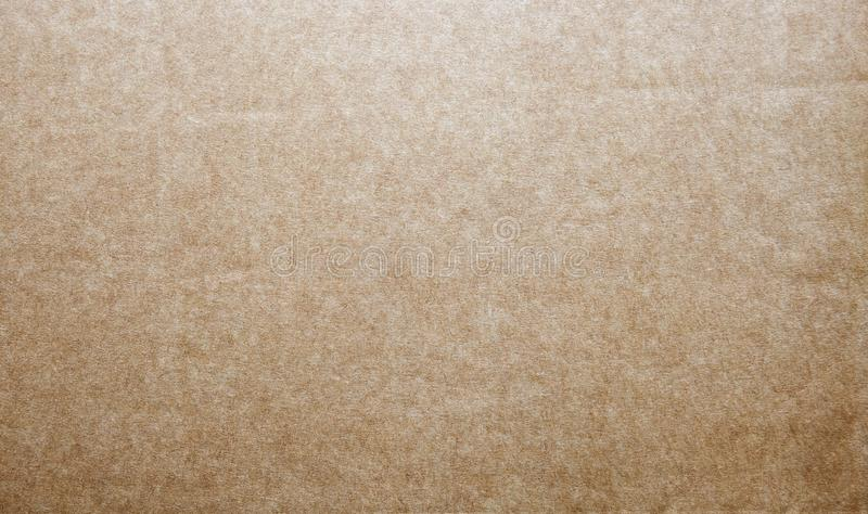 Hard brown kraft paper background with textures. Close-up hard brown kraft paper background with textures, Abstract backdrop design royalty free stock photo