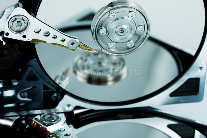 Close-up of hard drives with reflection. Close-up of hard drives needle and platter with reflection royalty free stock photos