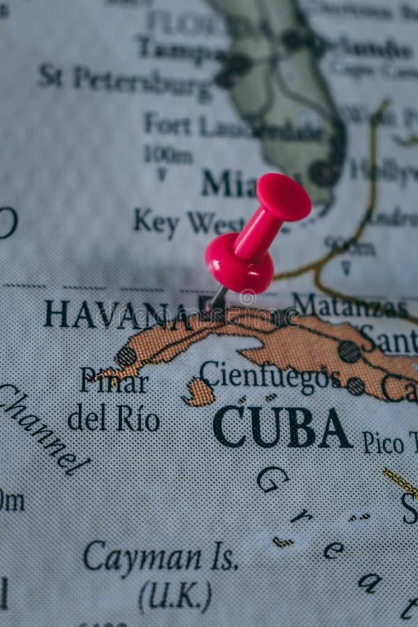 Close up of Havana pin pointed on the world map with a pink pushpin royalty free stock image