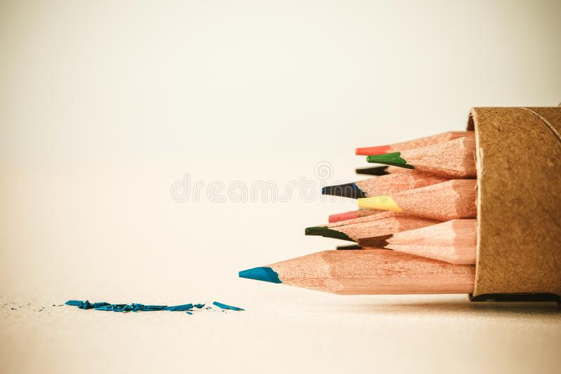 Close up head of blue color pencil on white drawing paper , cr royalty free stock photography