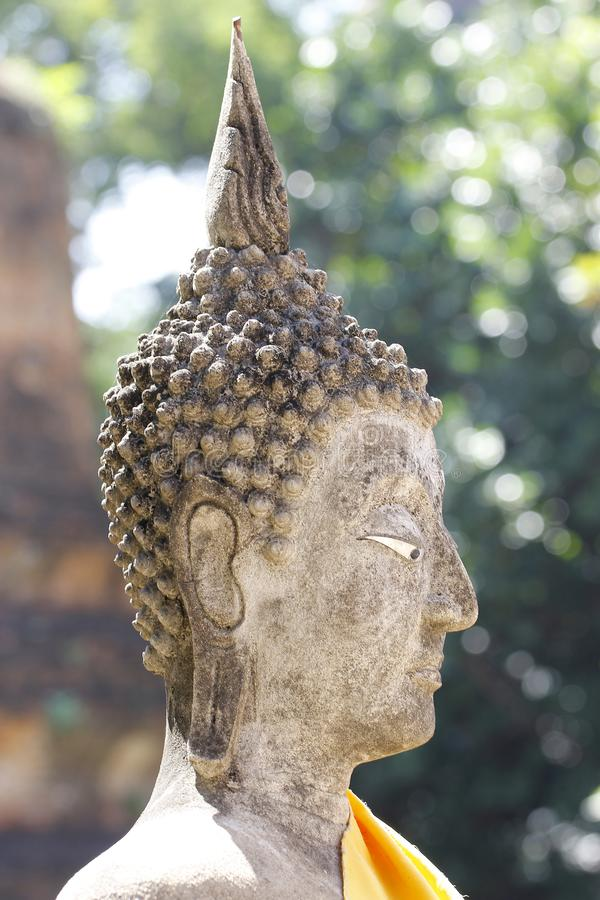 Close up head buddha status in thailand. Background, statue, beautiful, green, art, face, antique, culture, ancient, asian, religion, religious, temple royalty free stock photography