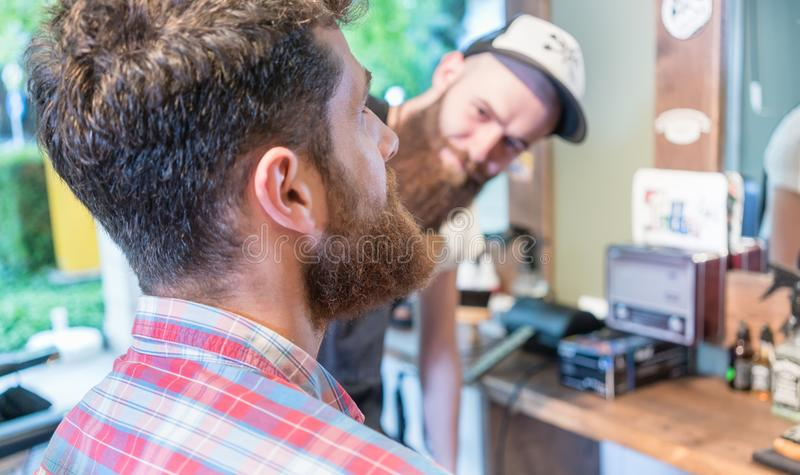 Close-up of the head of a redhead bearded young man ready for a haircut. Close-up of the head of a redhead bearded young men ready for a trendy haircut under the royalty free stock photo