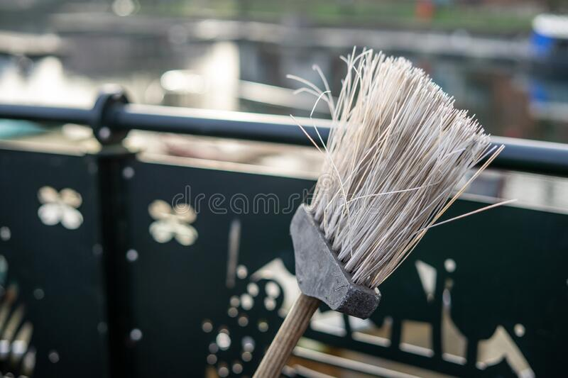 A close up of the head of a roadsweepers broom or brush with selective focus on the bristles stock photography