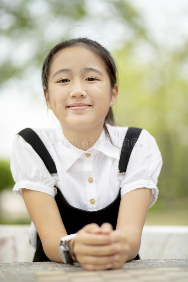 Close up head shop of asian teenager toothy smiling face outdoor royalty free stock images