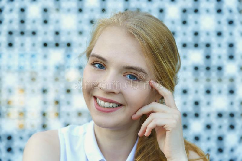 Close up head shot of smiling european blond haired young woman royalty free stock photo