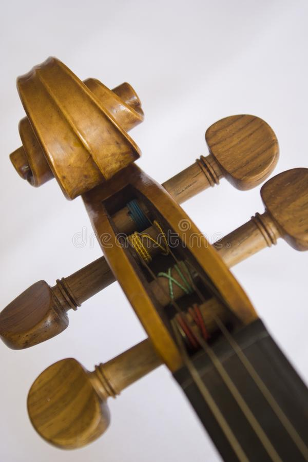 Head of a Traditional Violin Craftsmanship. Close up of head of violin in a white background stock photography