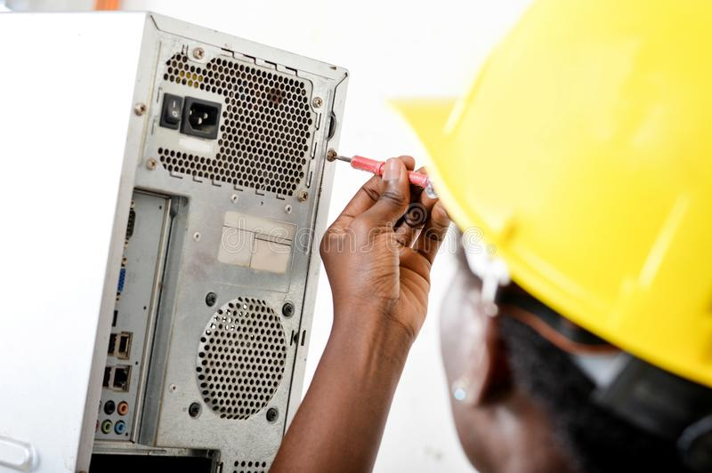 Close-up of the head of a worker opening a computer. royalty free stock image