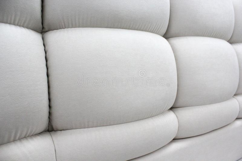 Close-up of the headboard. Soft panels. Chunky soft pieces of furniture. stock photo