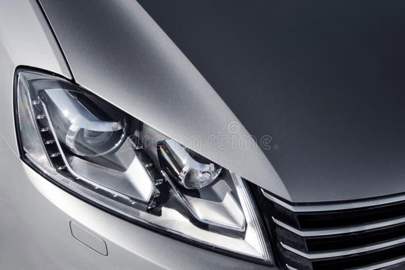 Close up headlight of grey car at daytime royalty free stock image