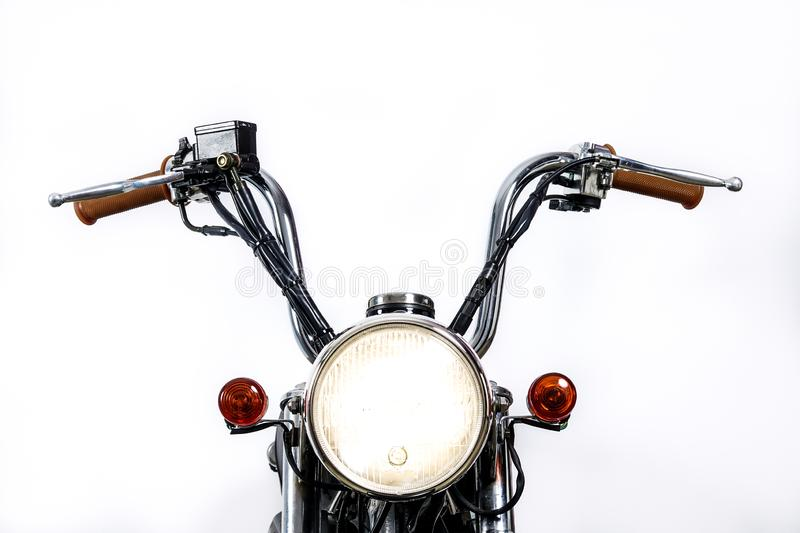 Close up of headlight on vintage motorcycle. Custom chopper / sc. Rambler motocross. Retro motorbike on white background. Blank copy space for text royalty free stock images