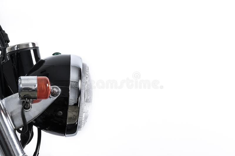 Close up of headlight on vintage motorcycle. Custom scrambler mo. Tocross. Retro motorbike on white background. Blank copy space for text royalty free stock image
