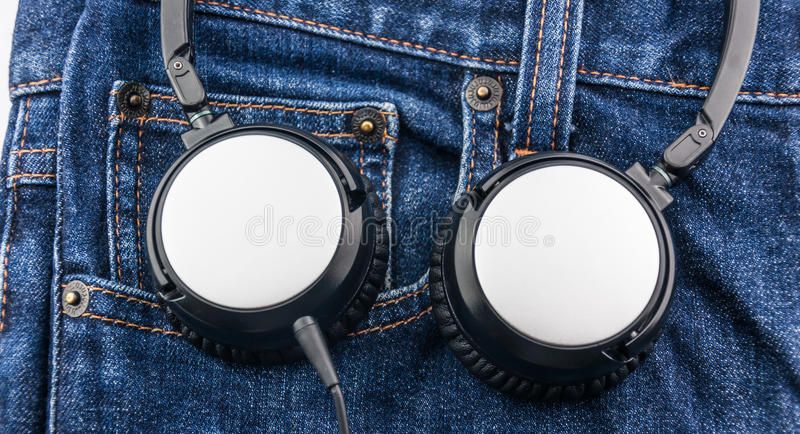 Close up headphone on blue jean background. Music concept royalty free stock photo